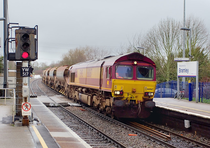 7th Feb 07:  66067 clatters the morning Engineers service from Hinksey to Eastleigh over the level crossing at Bramley