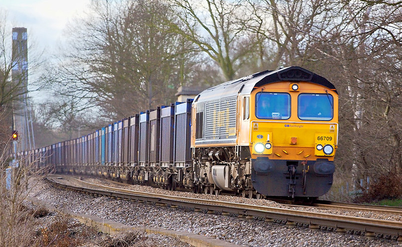 26th Feb 07:  66709 in Medite livery leaves the bridge over the M25 at Lyne hauling 4Y19 Mountfield to Southampton empty Gypsum containers