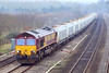 20th Feb 07: 66157 cruises passed with  raft of EWS white hoppers.