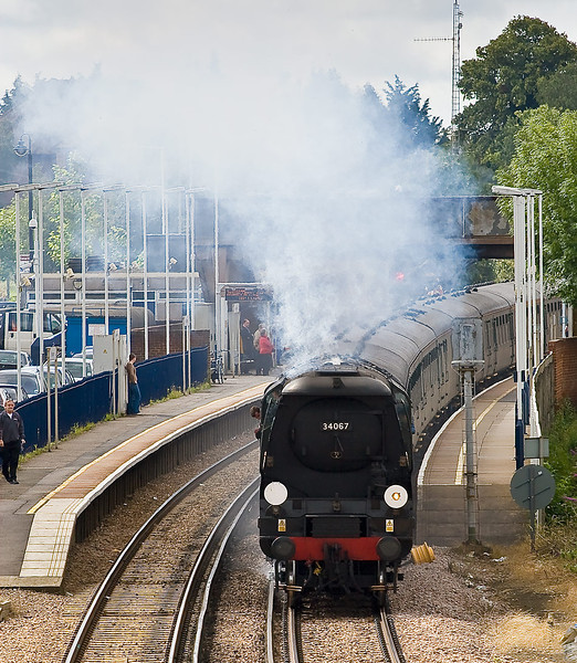 3td Jul 07:  The fireman takes a breather as 34067 Tangmere blasts through Wokingham with the Cathedrals Express bound for Stratford upon Avon