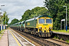 """14th Jul: Freightliner Heavy Haul's 66529 is tasked with 6Z42 the """"As required"""" Saturday only running of sand empties to Wool from Angerstein Wharf in South East London.  Captured here passing through Addlestone."""