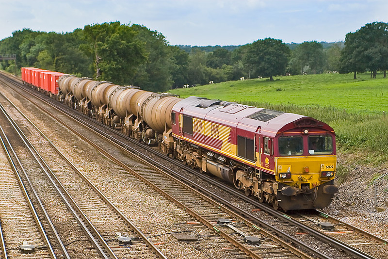 6th Jul 07:  With the Quidhampton Tanks on the front 66129 is in charge of 6M44 Eastleigh to Wembley Enterprise working