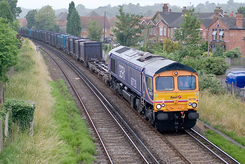 13th Jul 07:  As the drizzle falls the additional Southampton to Mountfield loaded Gypsum containers, running as 4Z68 and powered by 66726, winds it's way through Egham