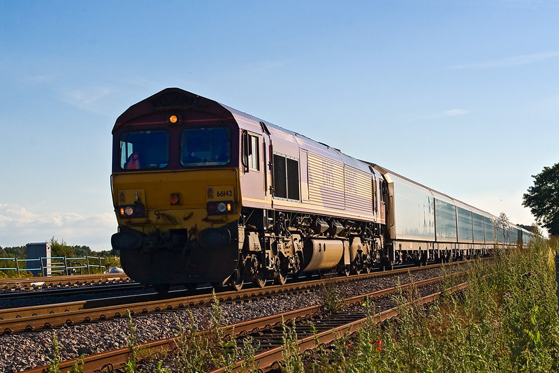 18th Jul 07:  66142 leads the Cowley to Purfleet car carrier passed the site of Ruscombe cross over. The line in the foreground is the truncated Up Goods Loop