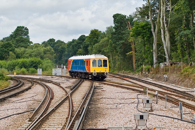 16th Jul:  SWT Bubble car 960012 straddles the junction with the Reading line as it arrives at Ascot