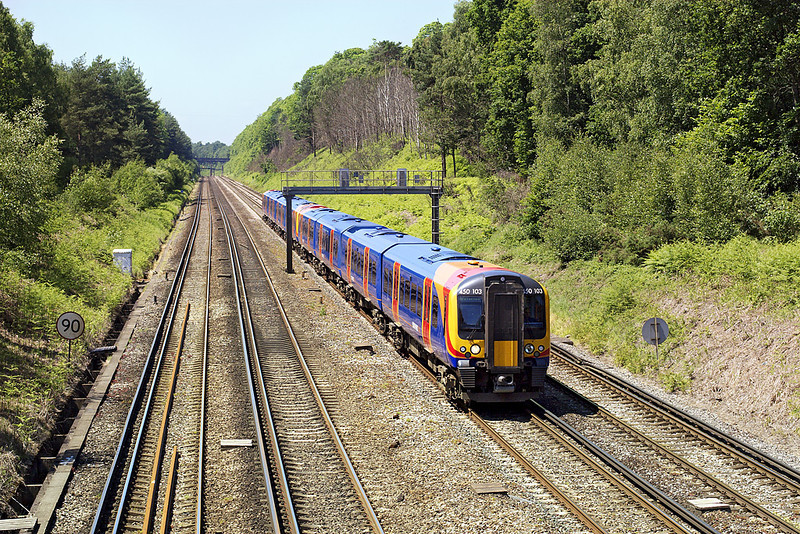 5th Jun 07:  450103/050 on the racing stretch heads to Waterloo from Portsmouth. Pirbright