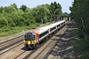 "1st Jun 07: Making for Southampton 444019 has just passed under the Flyover bringing the ""Up"" Farnham line over the SWML at Pirbright Junction"
