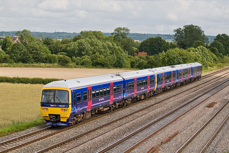 28th Jun 07:  The first 2 car 165 to be rebranded 165123 coasts to the next stop at Cholsey