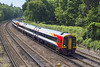 1st Jun 07:  159013 races under Curzon Bridge at Pirbright.  The Basingstoke Canal can be seen behind the train.