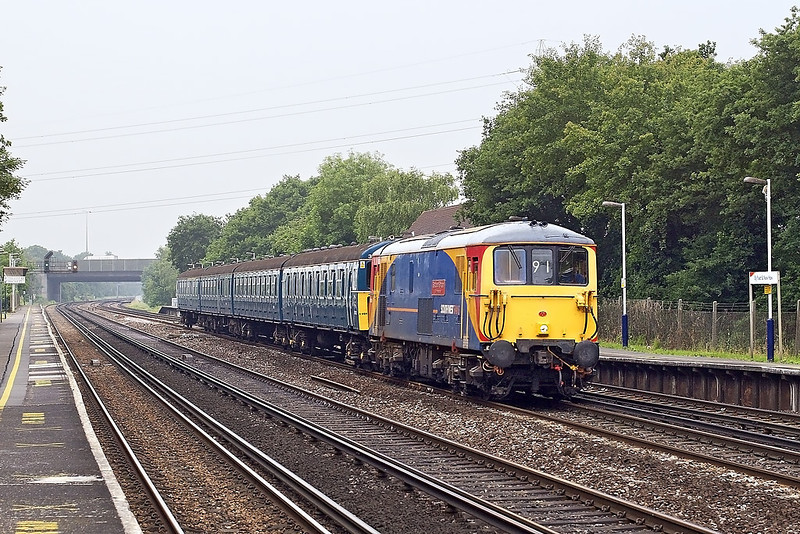 "9th Jun 07:  With a move unusual for a Saturday 73109 ""Battle of Brittain"" hauling heritage 4VEP 3417 races through Byfleet & New Haw during a particularly dull patch of light.  The move is to take the Slammer to the wheel lathe at Wimbledon Depot"
