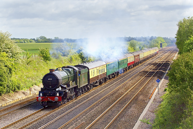 12th May 07: In a rare patch of sun GWR King 6024 beats down the relief taking 1Z47 to Bath & Bristol via the Berks and Hants line