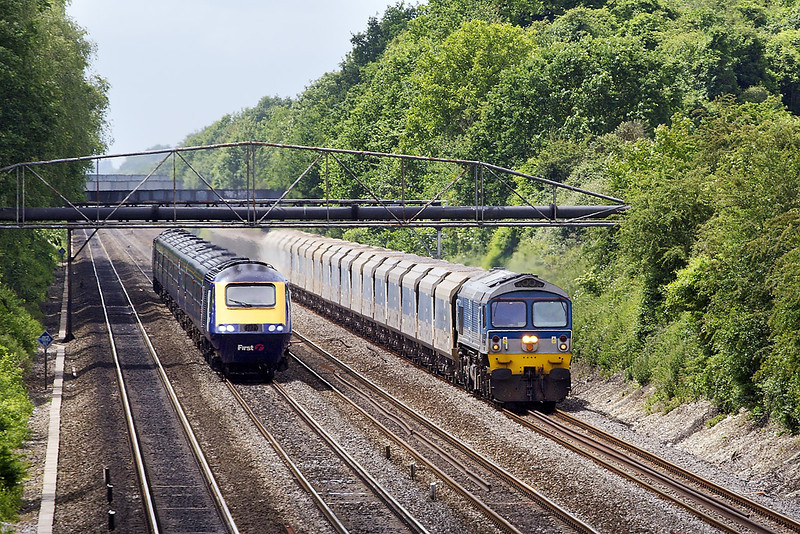 31st May 07:  59004 being overtaken by another HST. The working is 7A17 jumbo from Merehead to Acton