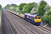 3rd May 07: 66724 heads 4E31 fron Fairwater Yard in Taunton to Peterborough.  The load is redundant concrete sleepers.