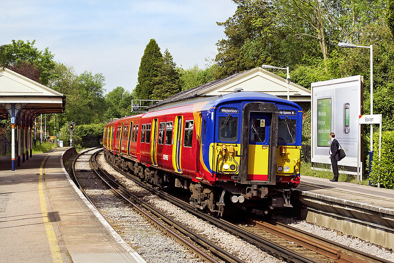 22nd May 07:  Glowing in the morning sun 455718 enters Bookham with the 09.28 from Guildford