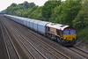 14th May 07: The cutting is now in shade as 66035 wheels the Cowley to Purfleet car carrier along the relief,