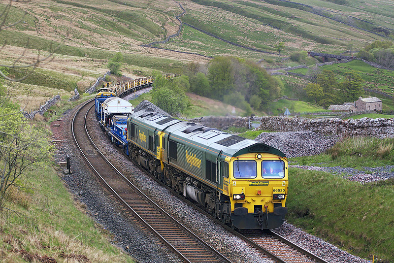 7th May 07:  Shortly after heavy rain 66530, with 66527 tucked inside, grinds the last few yards to Ais Gill summit with a CWR train