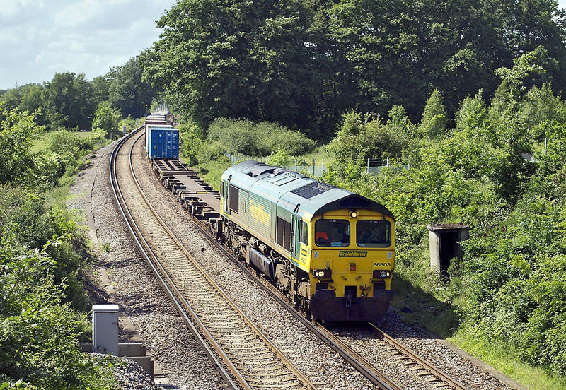 31st May 07: 66503 wheels 4O35 from Crewe through leafy Surrey at Lyne