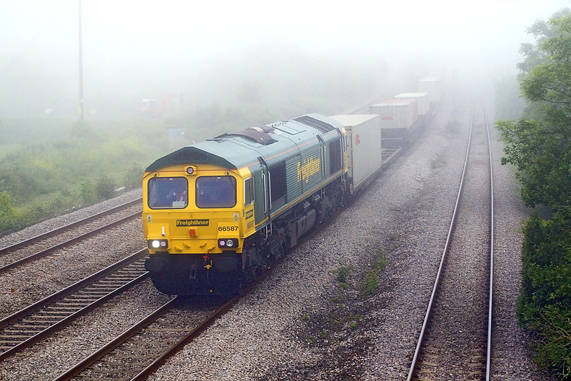 24th May 07: 8am and the first freight of the day.  66587 leads the Southampton to Wentloog liner through Magor