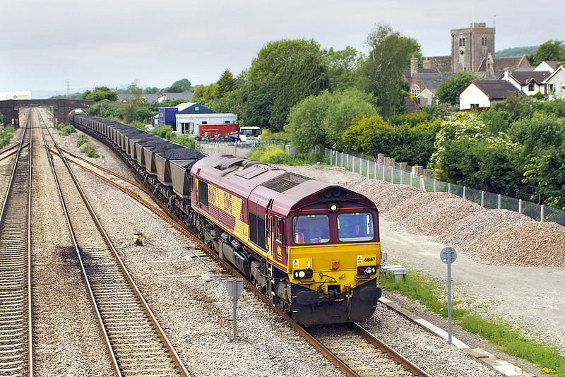 24th May 07:  66167 clatters through Magor with loaded HAAs for Westbury cement works from Park Slip Colliery