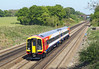 **3rd May 07: 158888 on it's delivery journey from Doncaster to Salisbury Depot rushes away from Winchfield