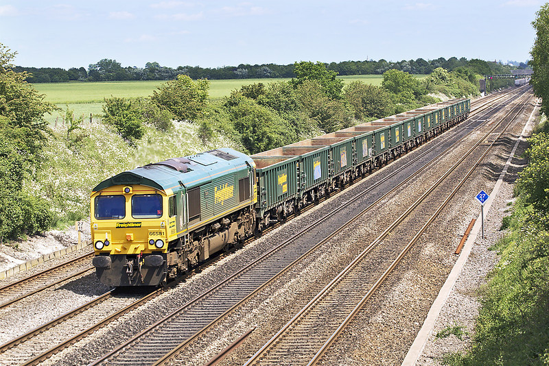 23rd May 07:  66581 with empty JNA's runs West.  The working is unknown