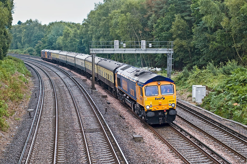 22nd Aug 07: On a dark, damp and dismal morning the GBRf staff Jolly from Victoria to Weymouth races through Pirbright with 66708 on the point