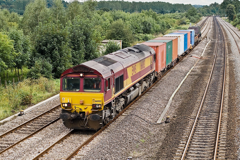 28th Aug 07:  66083 on 6V38 MArchwood to Didcot MOD working passes Lower Basildon