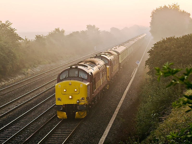 25th Aug 07: At 6.20 am with the sun starting to burn off the mist 37422 & 417 make for Eastleigh from Old Oak Common with stock for the Heart of Wales Explorer tour.  In the cool still air they could be heard coming and going away for a long time.  Gorgeous!