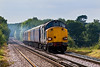 30th Aug 07:  In the days only patch of sun 37605 is leading as they pound up the grade through Wanborough Station