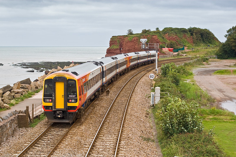 19th Aug 07: 159107 is about to pass Langstone Rock and run along the famous sea wall towards Dawlish. The service is the 13.15 Waterloo to Paignton