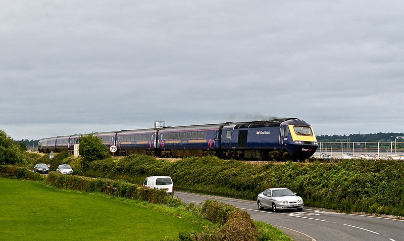 19th Aug 07:  Passing cars on the road from Starcross 43092 heads the 14.57 Paddington to Penzance