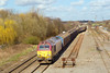 6th Mar 07:  67014 eases 6G42 Birch Coppice to Bescot Enterprise return working out onto the Main Line