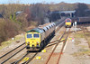 6th Mar 07:  66508 and 5 empty coal hoppers pass 67014 at Kingsbury Junction