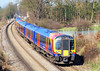 14th Mar 07:  450027 forms a Waterloo to Weybridge all stations, here passing the M25 at Lyne
