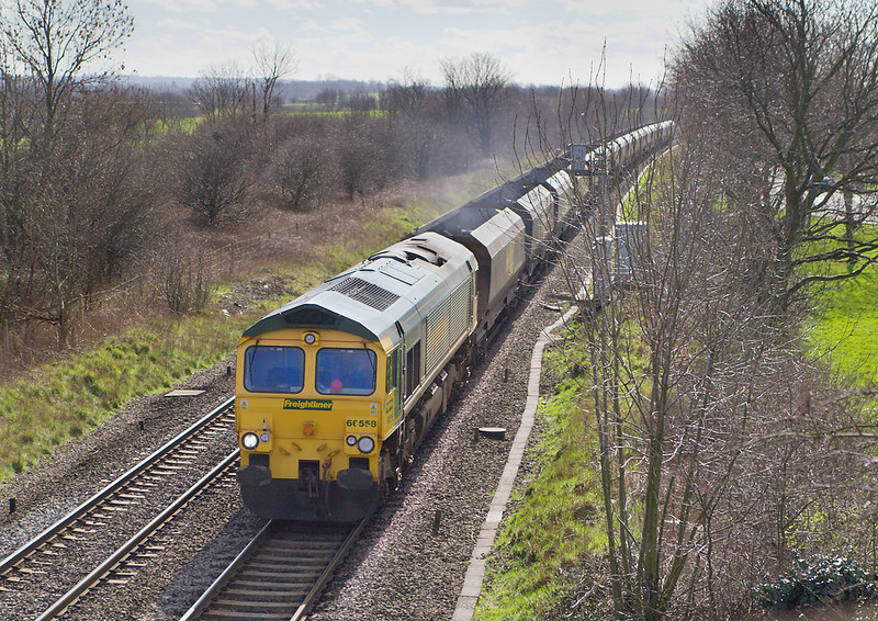 6yh Mar 07: 66558 rushes the Rugeley PS to Barrow Hill empties northwards