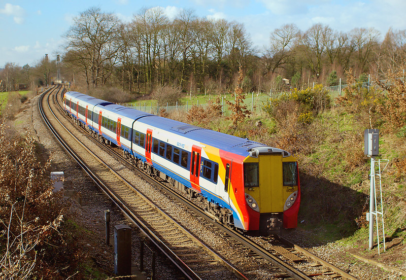 9th Mar 07: Juniper 458030 forms an all Stations from Waterloo to Weybridge. The next stop will be Chertsey