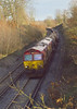 9th Mar 07:  66176 heads 6M44 Eastleigh to Wembley Enterprise service and will shortly burst into the sunlight as it approaches the bridge over the M25