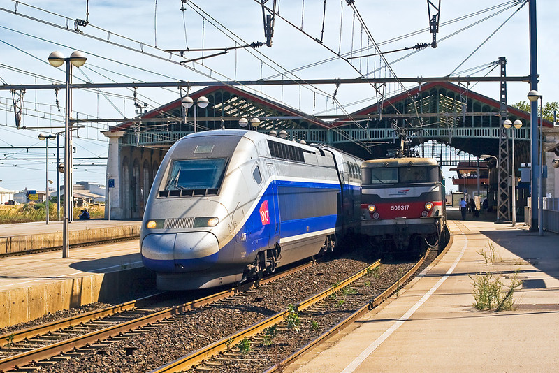 "4th Sep:  509317 waits in platform""A"" with it's train to Cordoba in Spain as a ""Duplex"" TGV over takes with a Paris to Perpignon working"