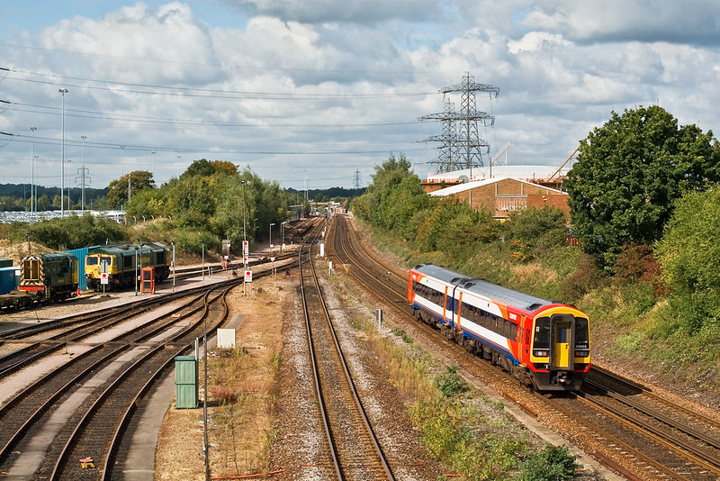 26th Sep 07:  158885 on the shuttle service passes the Maritime Fuel Point and heads towards Redbridge