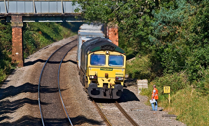 18th Sep 07:  A track surveyor stands aside as 66503 races south on the 06.13 from Leeds to Southampton