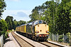 25th Sep 07: With 37059 now leading the Serco rushes down the hill through Sandhurst Station.
