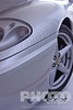 Custom  grey Ferrari show car, front quarter detail of front hood and wheel