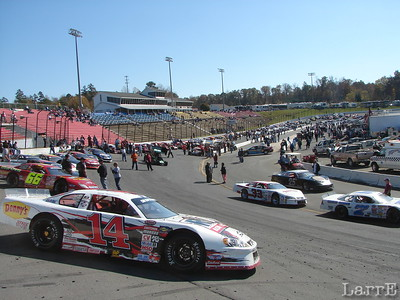 all race cars lone up on the track at noon