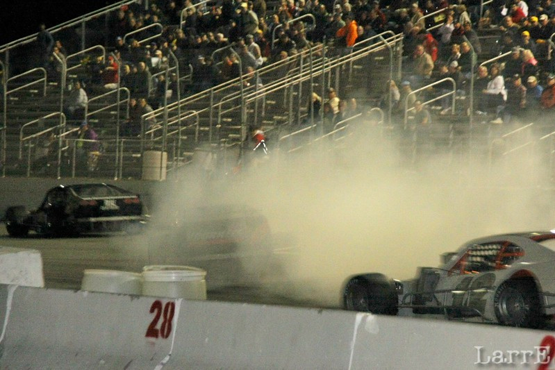 drivers try to guess where he is in the smoke