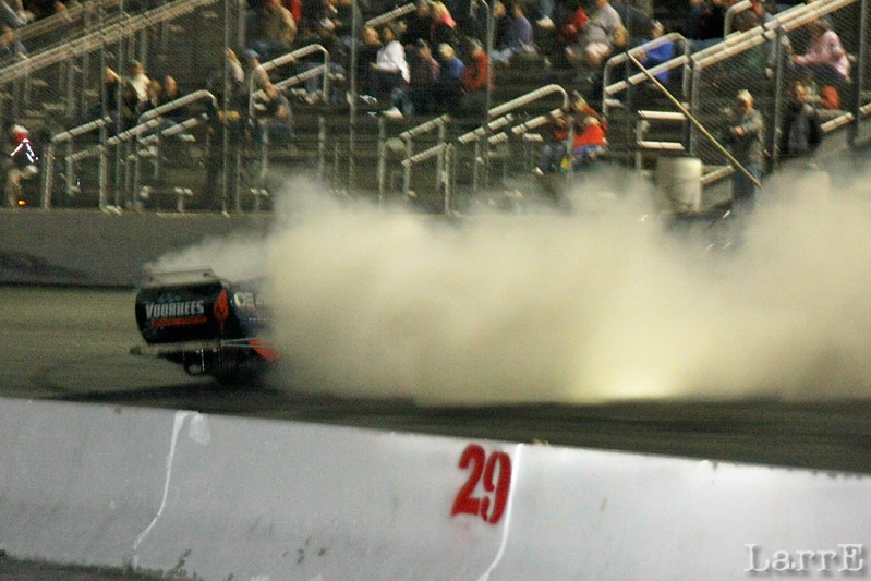 ..,and dissapears in a cloud of smoke as he spins down the straight