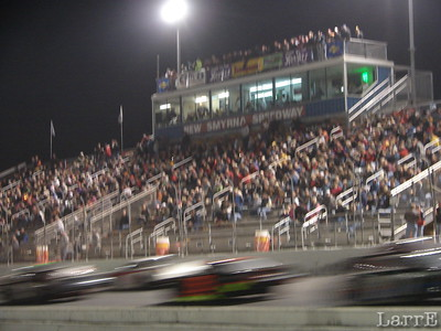 Large crowd watches the start of a feature race