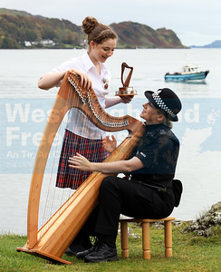 Oban's gaelic speaking police officer, Ketherine MacKinnon picks up some tips on the clarsach from prize winner Kristina MacDonald.
