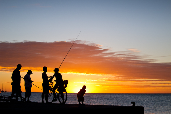 Local fishermen at sunset (Moorea, French Polynesia)