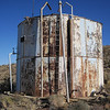 Old railroad water tank rebuilt to serve mining operations.