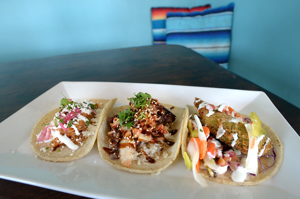 . LYONS, CO: August 29: A selection of tacos including Korean beef, chicken tinga. Restaurant Review of  Mojo Taqueria in Lyons, CO on August 29, 2018. (photo by Cliff Grassmick/Staff Photographer).